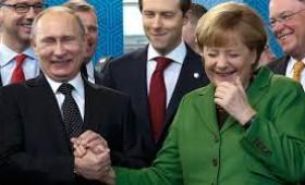 De ce apelează Putin la Merkel
